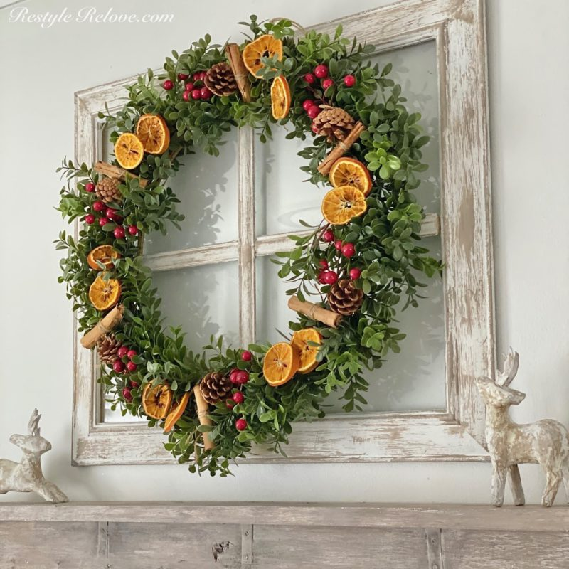 boxwood wreath with oranges and berries