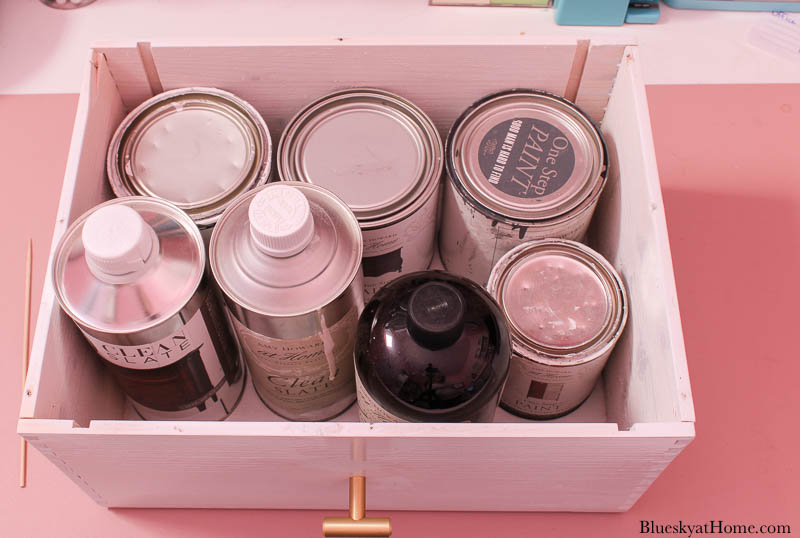 storage drawer with paint cans