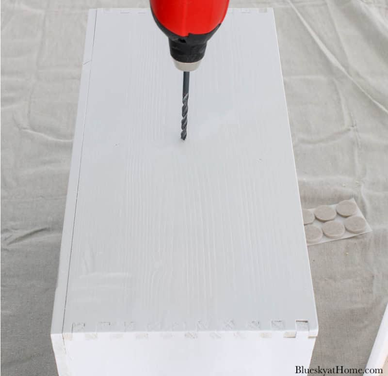 electric drill in white drawer