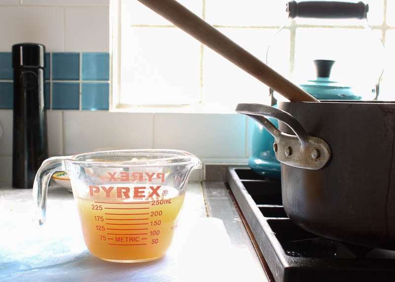 chicken stock in measuring cup