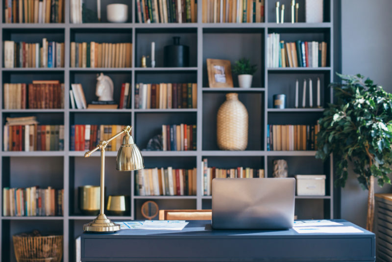 home office with blue bookshelves