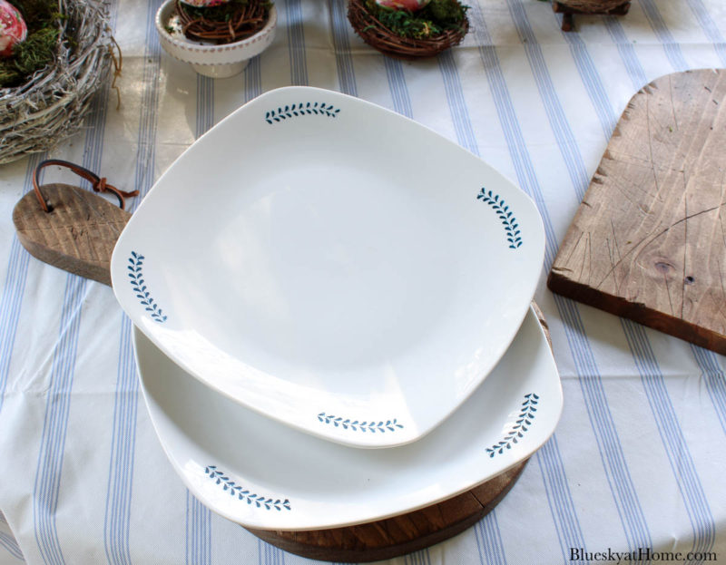 white dishes with blue designs