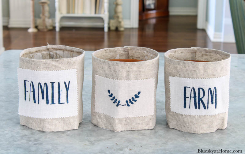 fabric-covered clay pots with stencil design