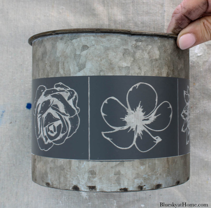 galvanized container with spring flower design