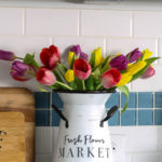 container with spring tulips