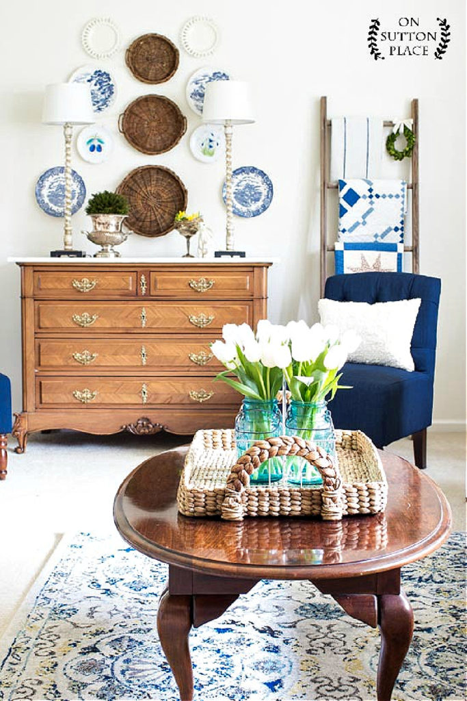 spring living room with blue chair and blue plates