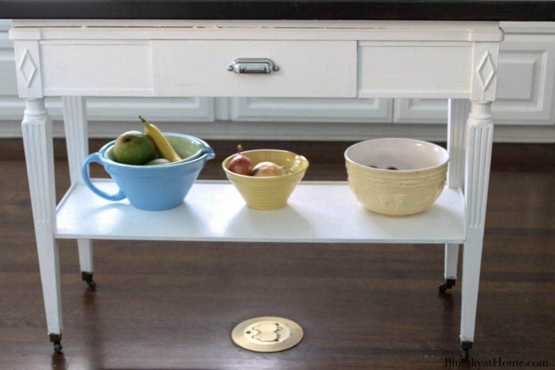 lower shelf with yellow and blue bowls