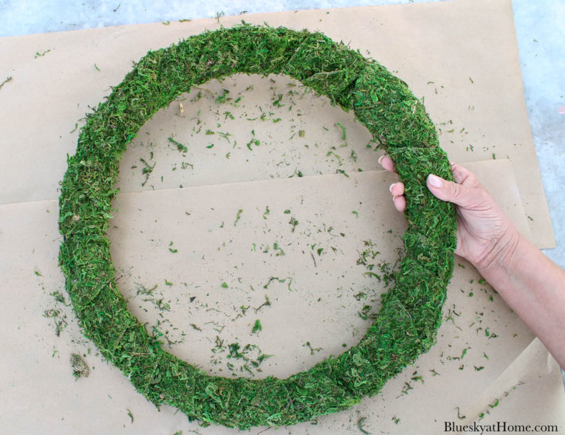 wired wreath covered in moss ribbon