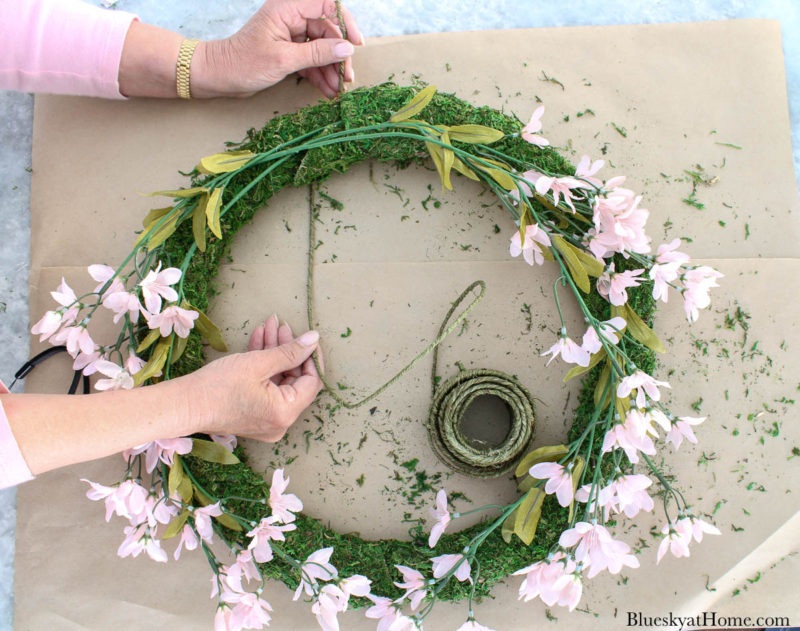 wrapping spring wreath with wired twine