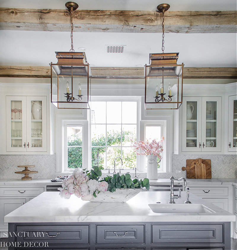 spring kitchen with island and pink flowers