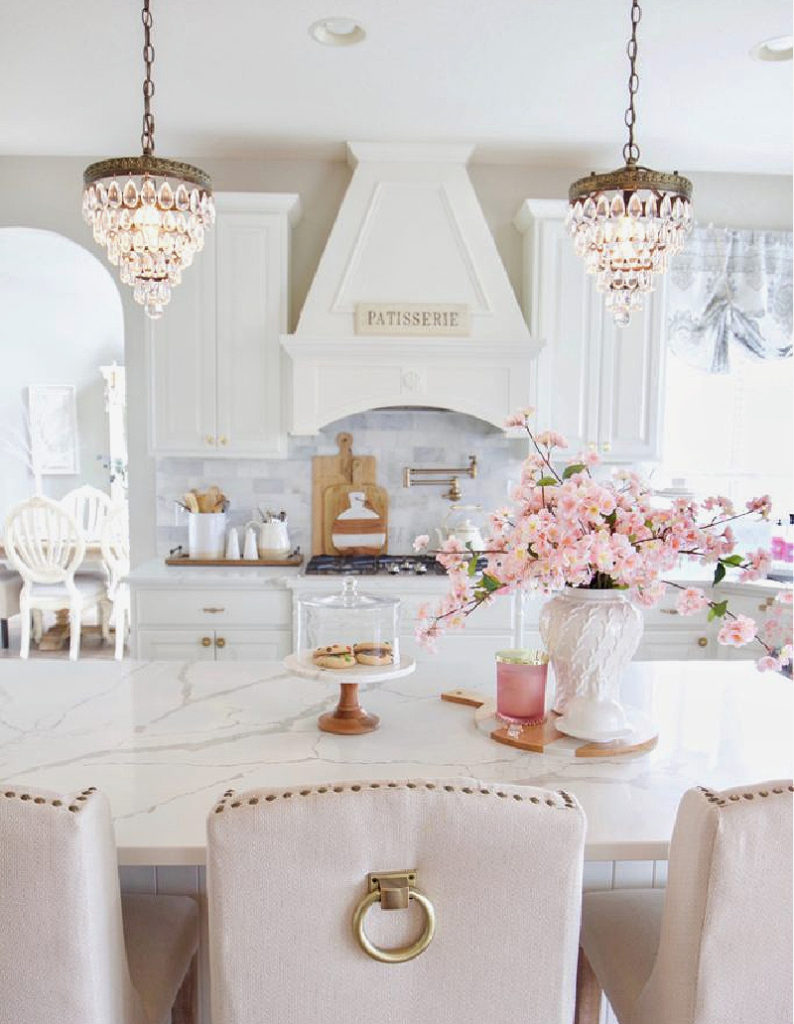 kitchen with chandeliers and pink flowers