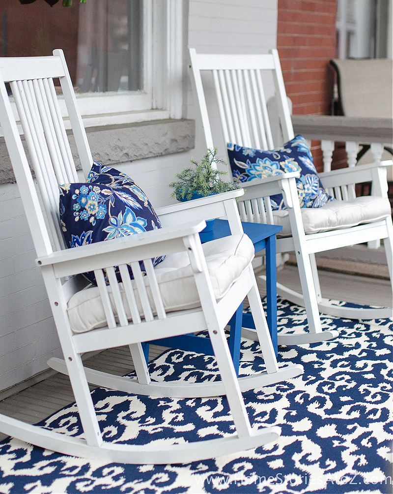 white rocking chairs on blue rug