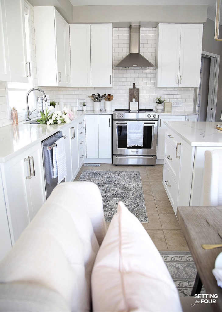 spring kitchen with rug and white counters