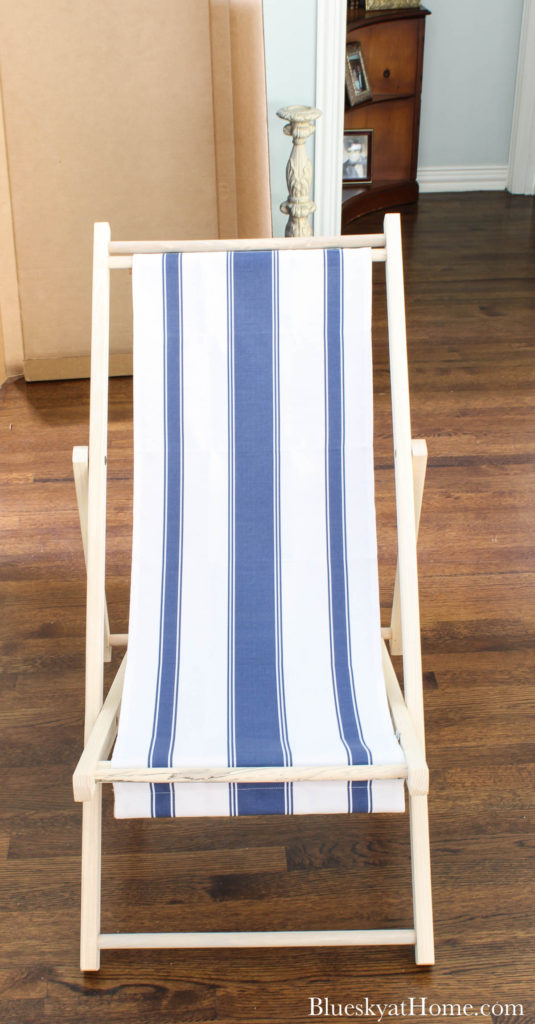 cabana chair with blue and white stripe fabric sling