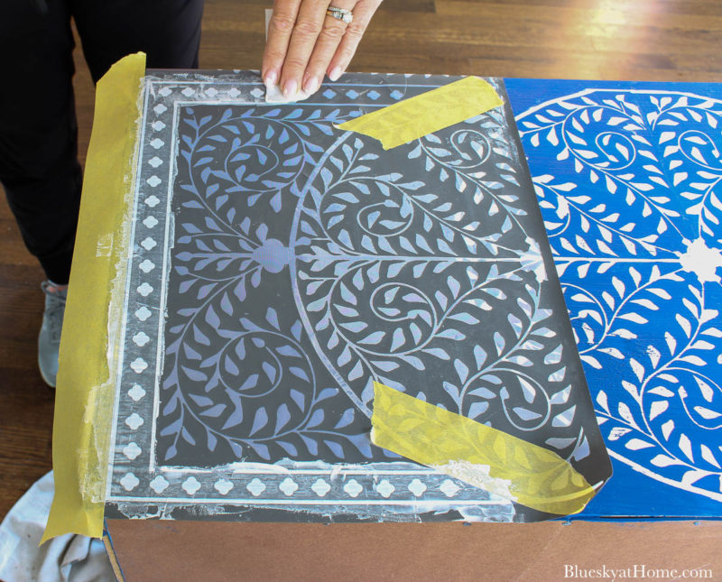 stencil design on cabinet with painters tape