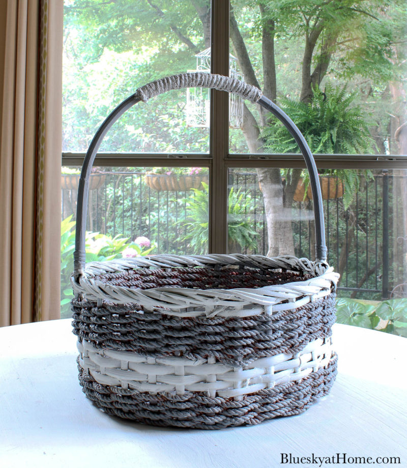 grey and white basket with handles
