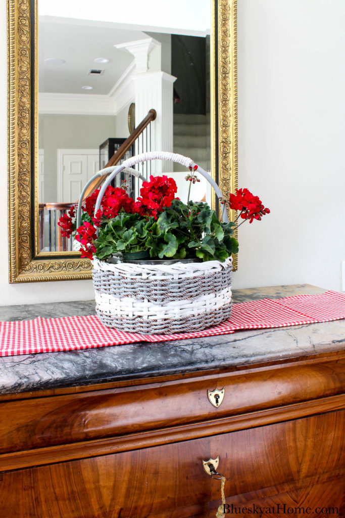 decorated basket with red geraniums