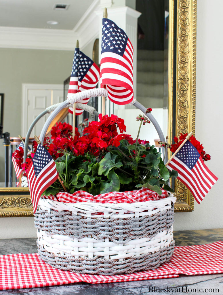 decorated basket with red flowers and American flags