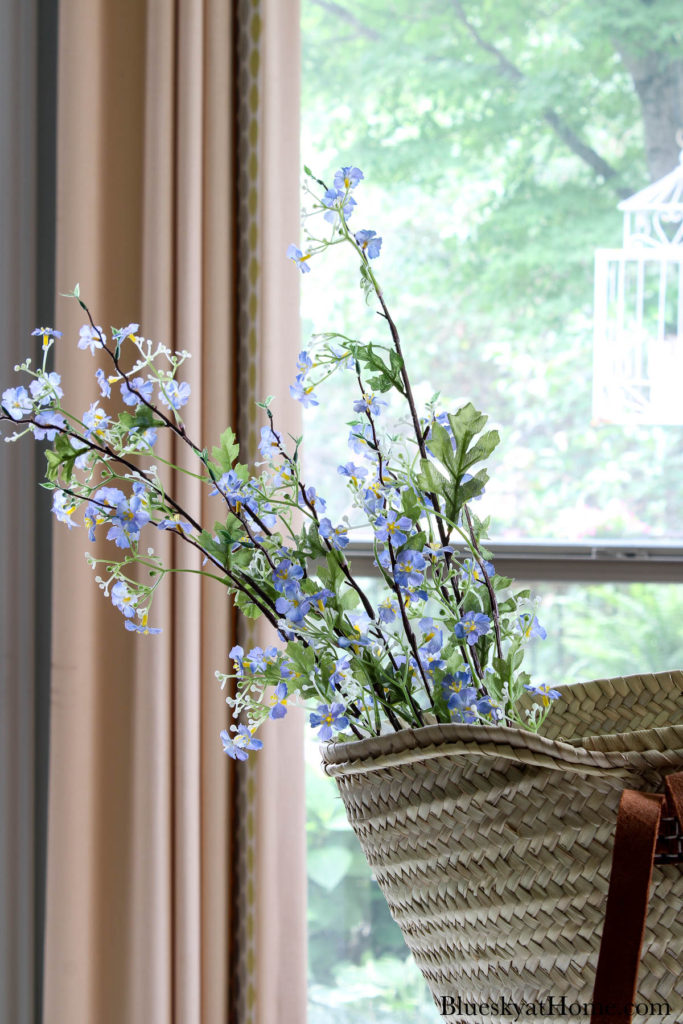 decorated basket with blue flowers