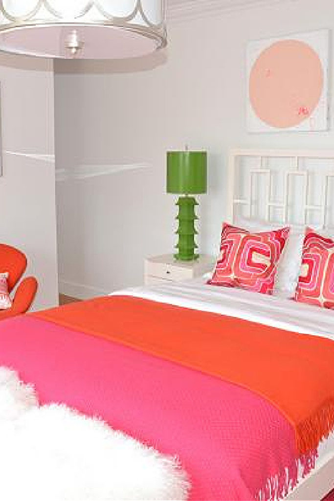summer bedroom with bright pink HGTV bedding and green lamp