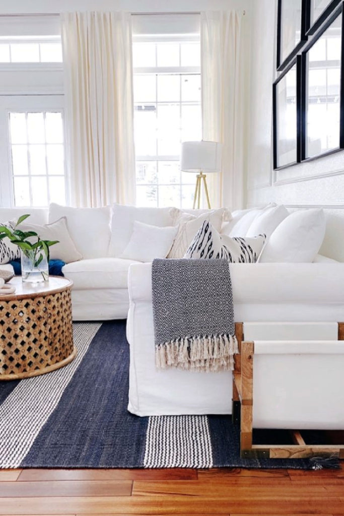 summer white sofa and blue rug and throw