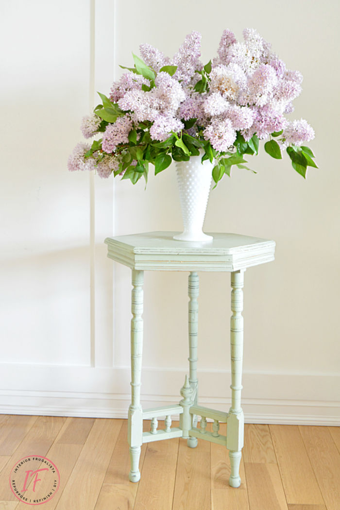 small white table with pink flowers