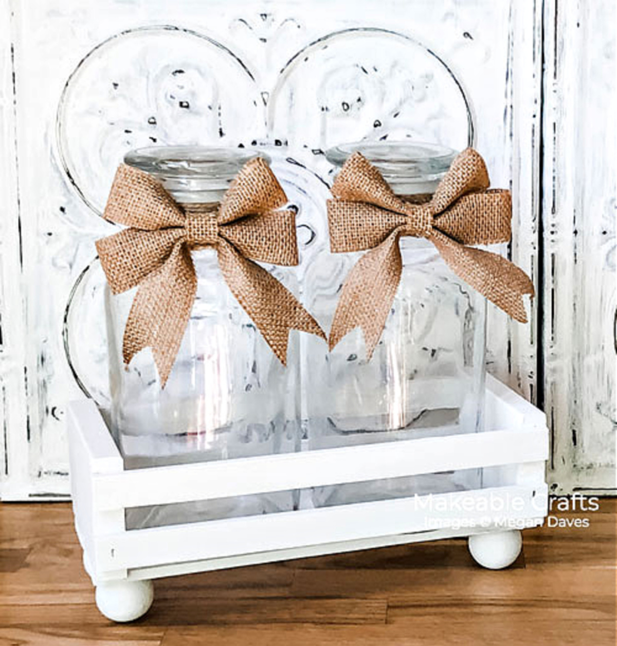 white CD crate with glass jars