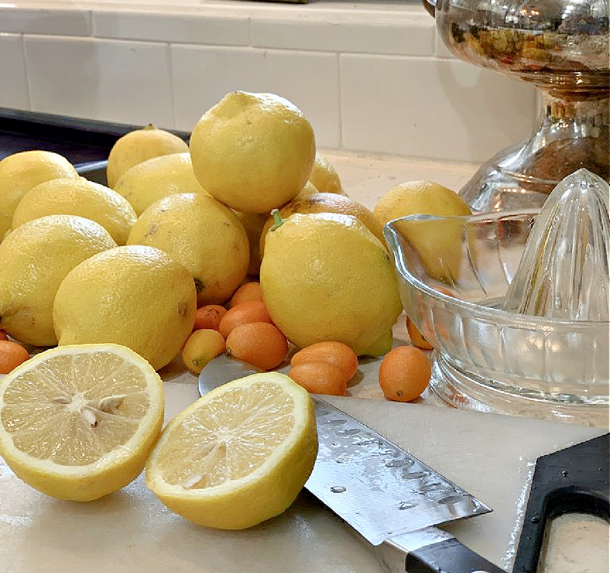 lemons on counter with knive