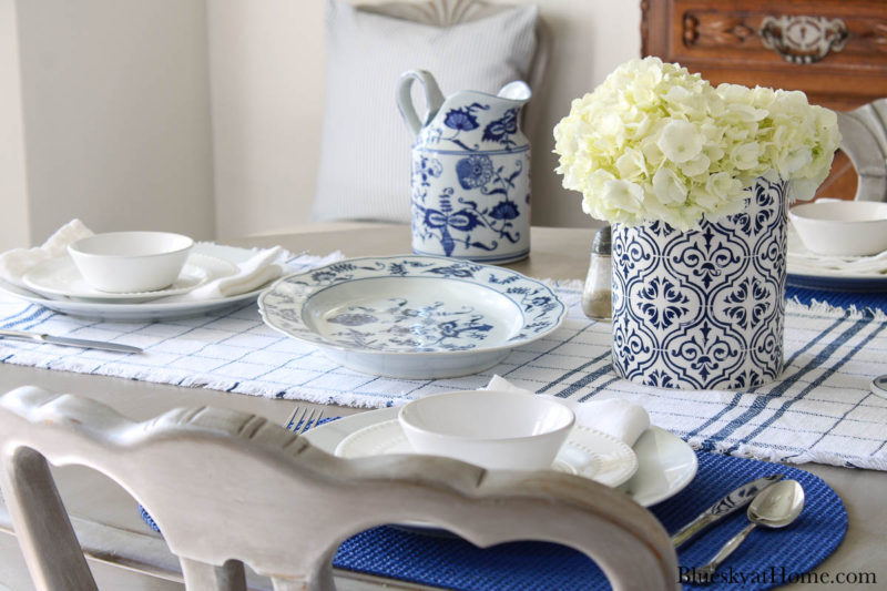 blue serving pieces and vase with white flowers