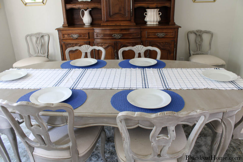 blue and white check runner on table with blue placemats wnt white plates