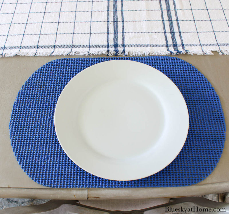 white plate on blue placemat