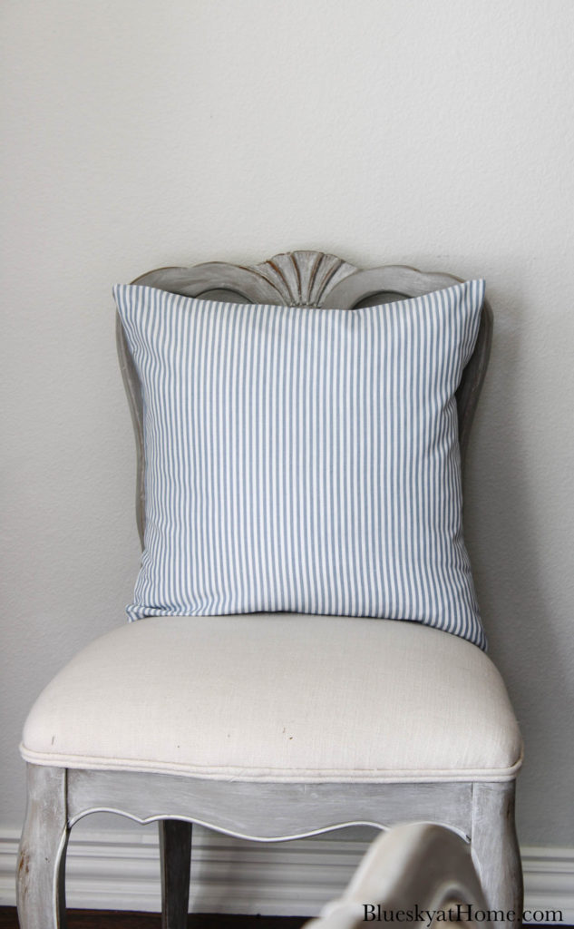 blue and white stripe pillow on chair