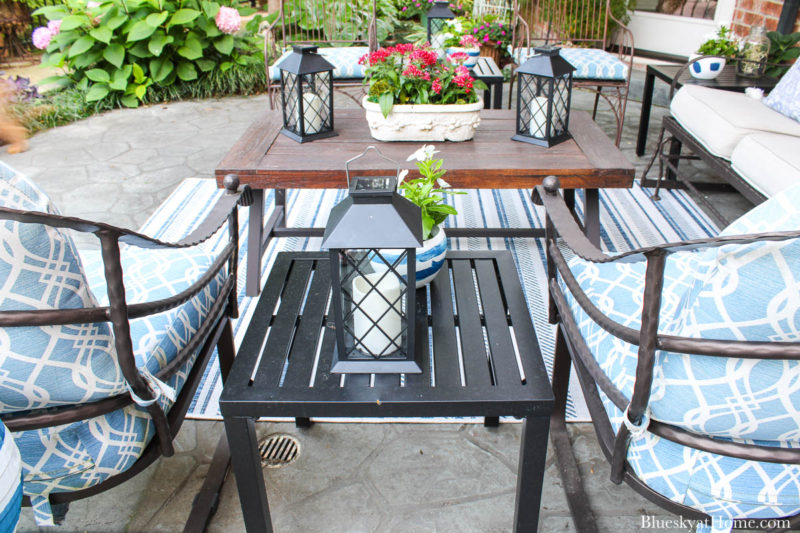 patio black table with lantern in seating area