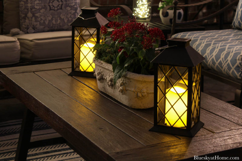 patio lanterns with candles at night