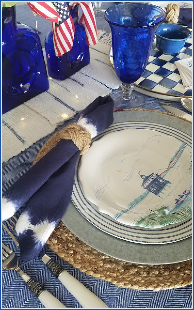 place setting with blue and white plates and napkins