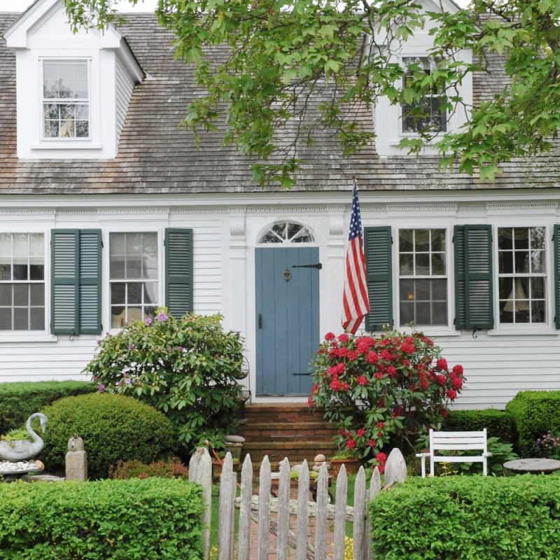 white house with a blue door