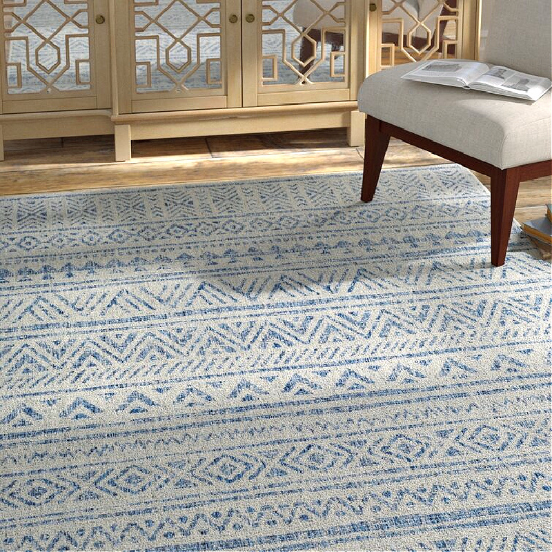 blue and white pattern patio rug