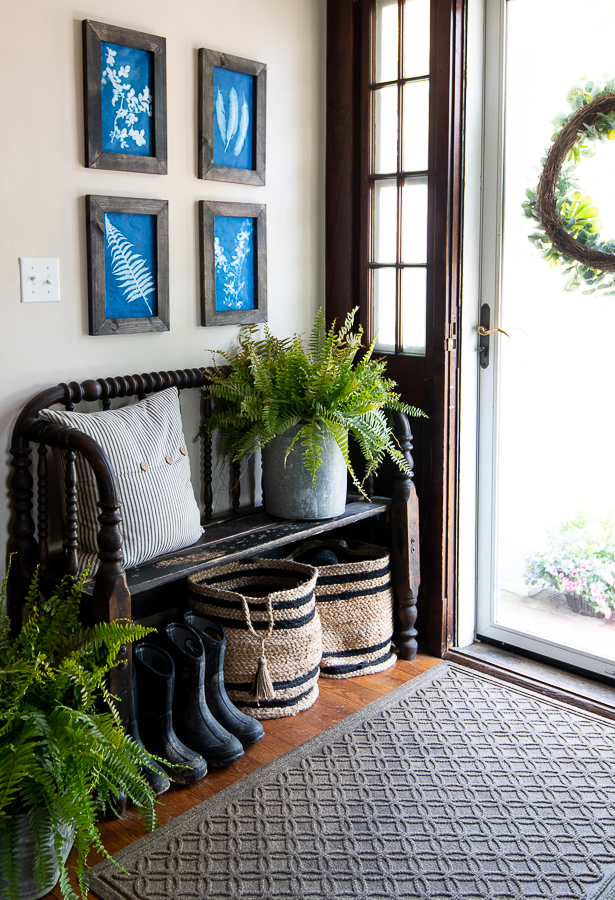entry with bench and blue art prints