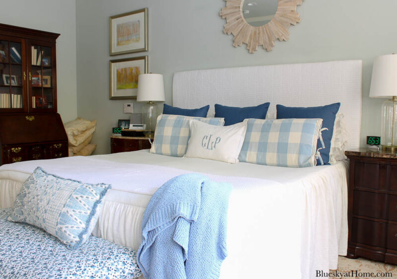 bedroom with fabric-covered headboard