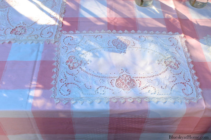 pink and white table cloth with white placemat