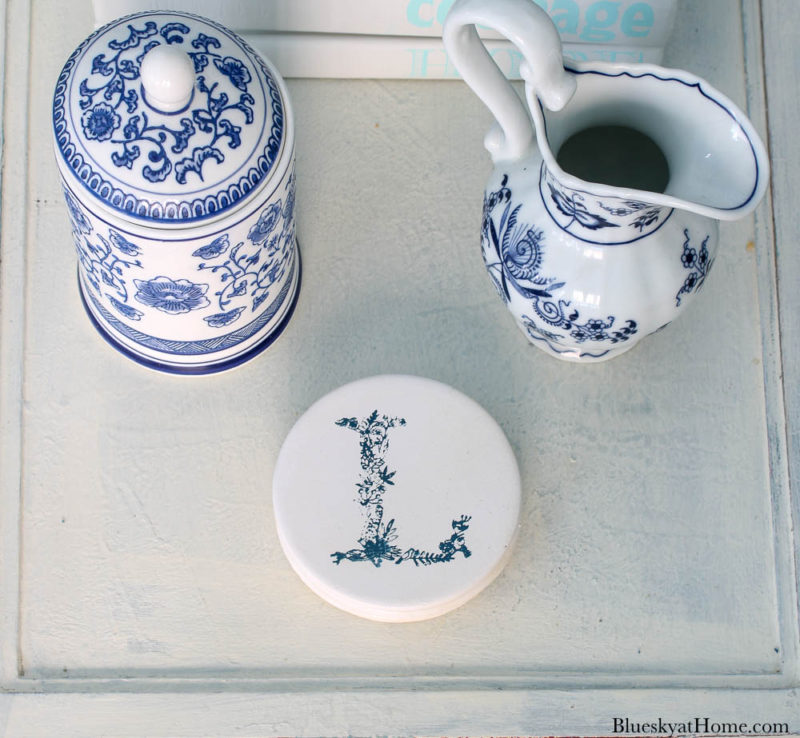 monogrammed coasters with blue letter L on table
