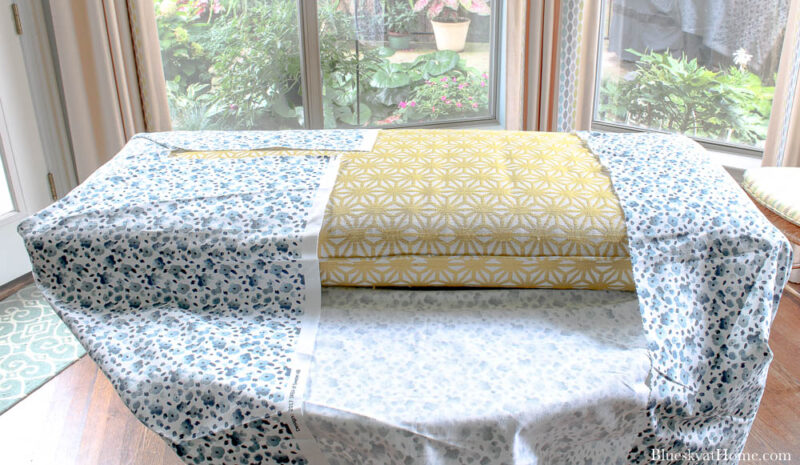 wrapping no~sew bench cushion with blue fabric