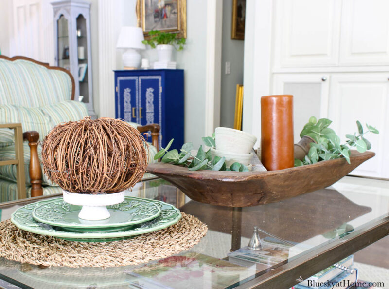 fall coffee table vignettes with orange candle and pumpkin