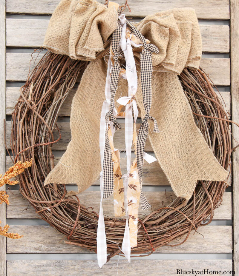 grapevine wreath with burlap bow and fabric