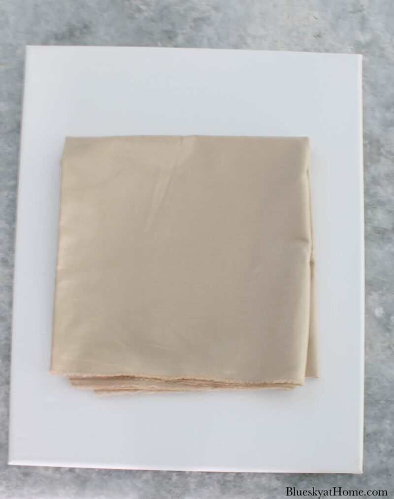 large canvas with beige fabric