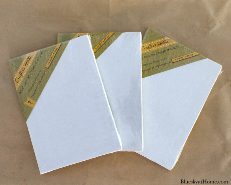 3 sets of white canvases