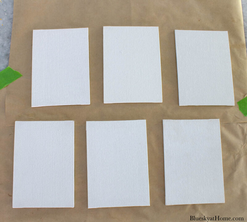 6 small white canvases