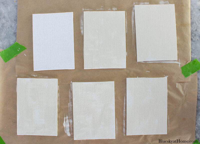 painted small white canvases
