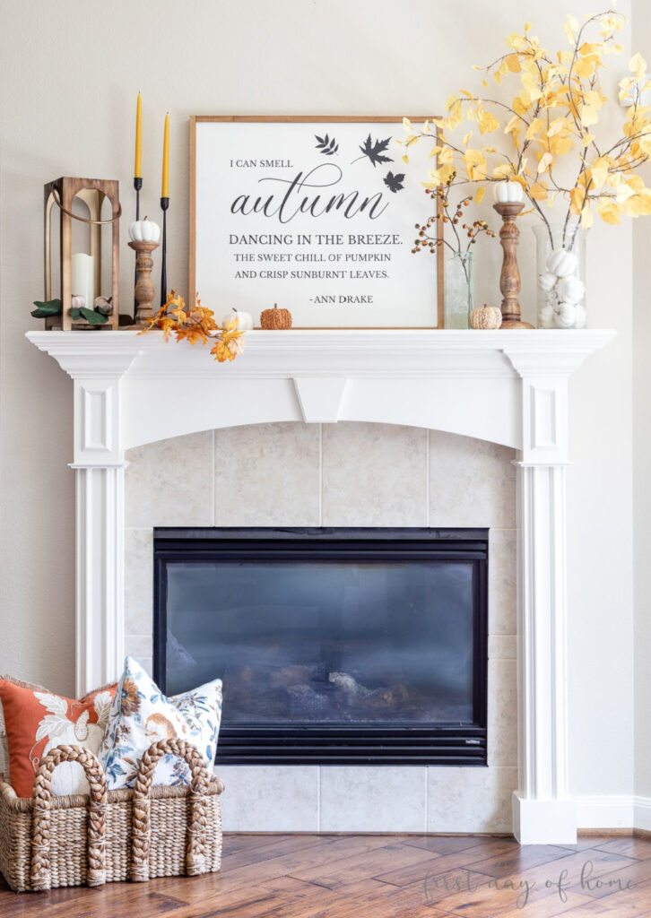 fall mantel with candlesticks and lantern