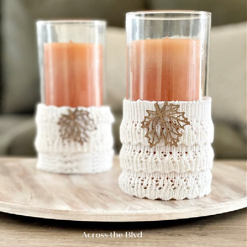 orange candles with white sweater sleeves